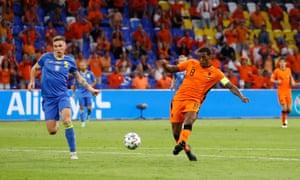 Georginio Wijnaldum of the Netherlands (left) slots the ball home.