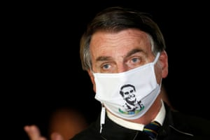 He may question the need for lockdowns but Brazil's president, Jair Bolsonaro, wears a mask depicting ... himself ...at Alvorada Palace in Brasilia