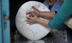 Get it while you can: a halloumi takes shape in the expert hands of Cypriot women.