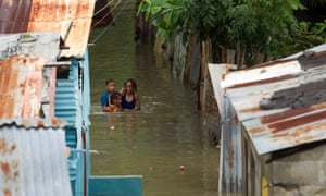 A flood in Santo Domingo, capital of the Dominican Republic, which shares the island of Hispaniola with Haiti