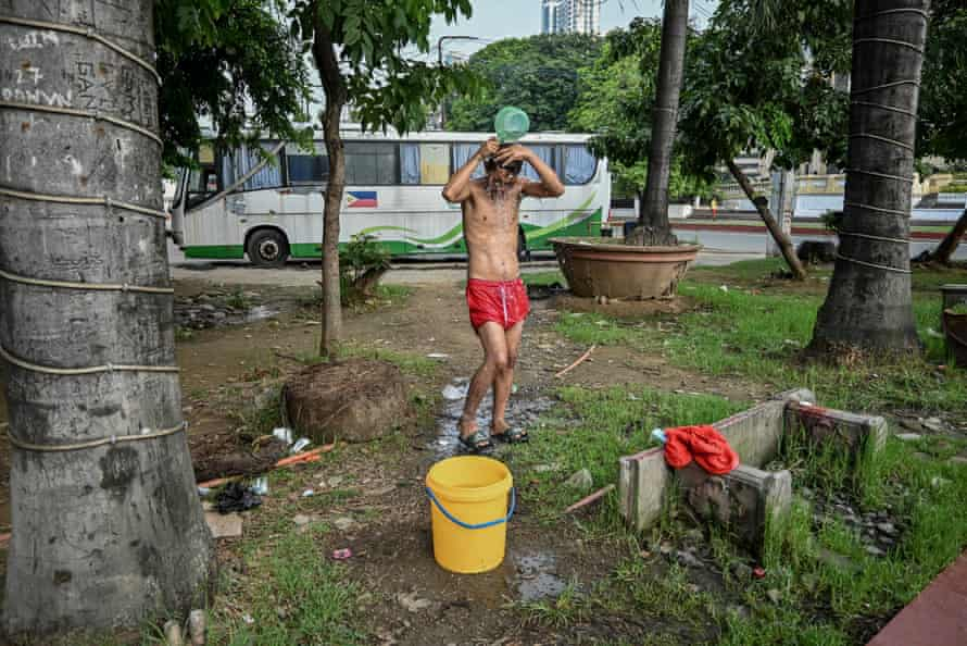 People have been advised to maintain physical distancing and practise good hygiene to help curb the spread of Covid-19. Some homeless people use unfiltered water from the park's fountain for bathing