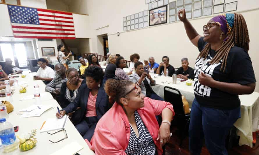 LaTosha Brown, co-founder of Black Voters Matter, leads an organizing song at a meeting of several grassroots organizations in Greenville, Mississippi, August 2018.