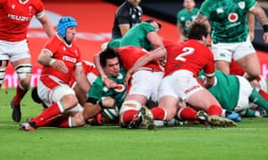 Ireland's Quinn Roux scores their first try.