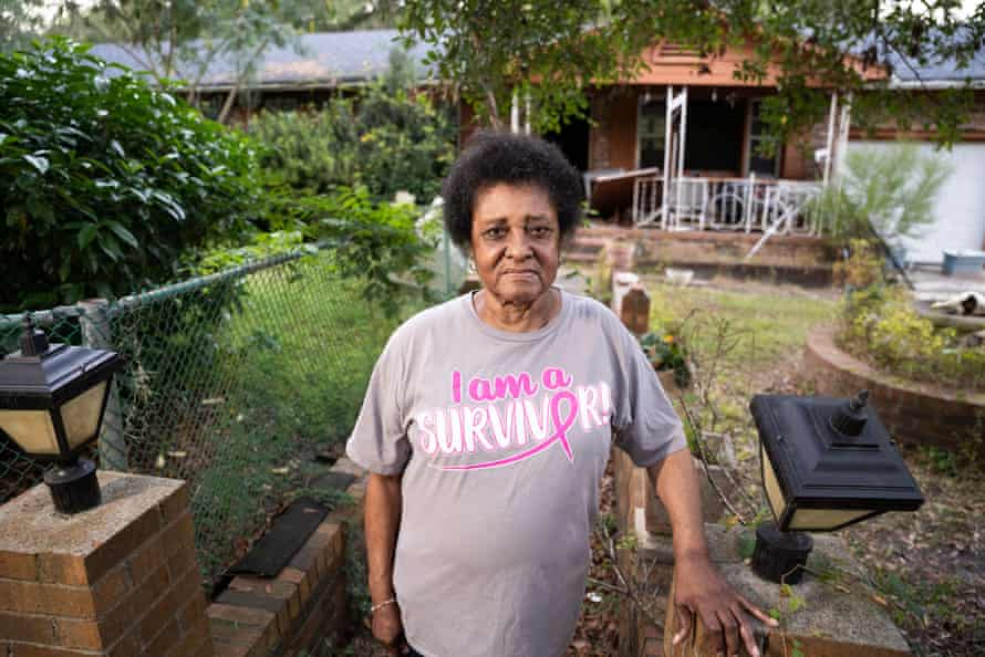 Margaret Alston outside her storm-damaged home in Bucksport, South Carolina. Alston has not been able to access the necessary federal and private funds to repair the house because her name is not on the deed.