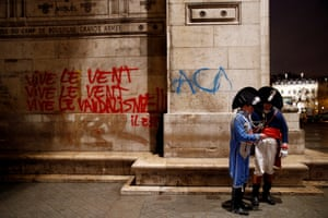 Graffiti is seen on the wall at the Arc de Triomphe the day after clashes with protesters
