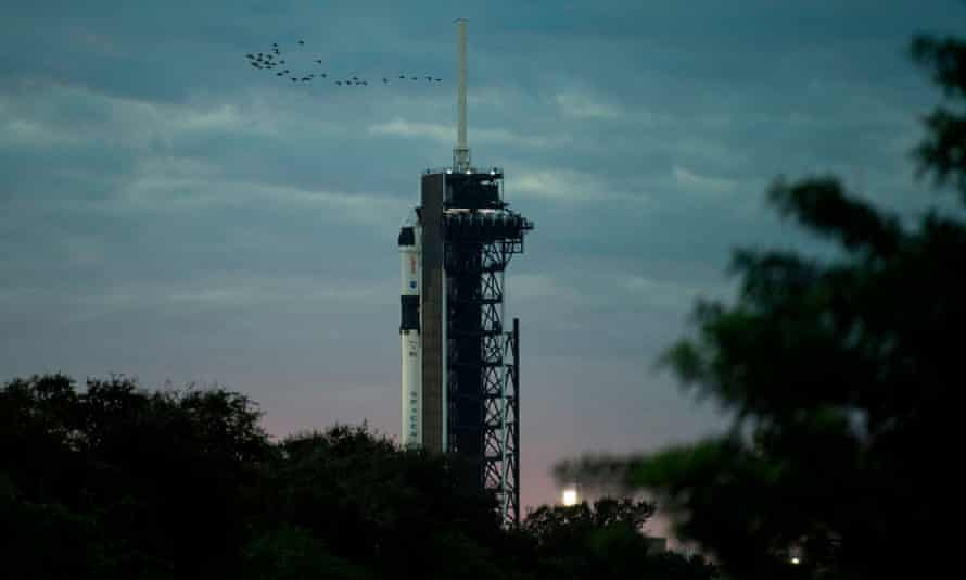 A SpaceX Falcon 9 rocket with the company's Crew Dragon spacecraft onboard on the launch pad at Launch Complex 39A as preparations continue for the Crew-1 mission