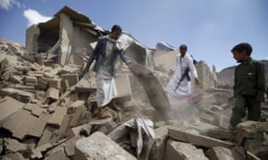 People salvage furniture from the rubble of a house destroyed by a Saudi-led air strike in Yemen's capital Sanaa on Saturday.