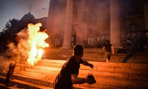 Belgrade, Serbia: Protesters clash with police in front of the National Assembly building during a demonstration against a weekend curfew announced to combat a resurgence of Covid-19 infections