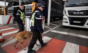 Customs officers in Calais with a sniffer dog