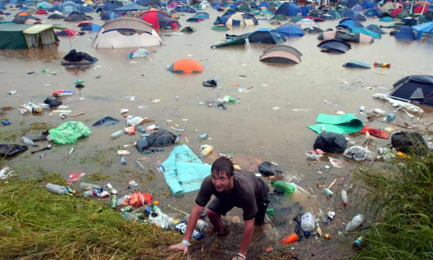 The notoriously soggy festival was badly flooded after a thunderstorm.