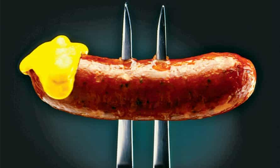 Sausage on a fork with mustard
