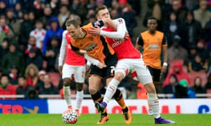 Arsenal's Calum Chambers, right, gets to grips with Hull City's David Meyler.