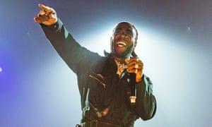 Burna Boy performing at Wembley Arena.