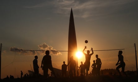 A game of beach volleyball at sunset in St Petersburg. The game is popular around the world