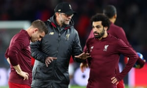 Jurgen Klopp speaks to Mohamed Salah and James Milner, who started in midfield alongside Jordan Henderson and Gigi Wijnaldum.