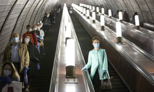 People wear face masks and gloves on the Moscow Metro. Russia now finds itself with the second fastest rate of Covid-19 infections in the world.