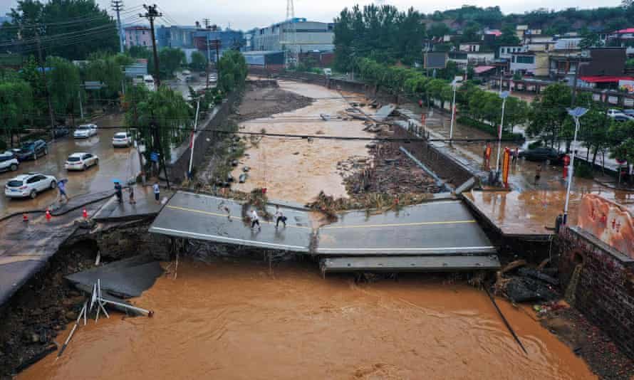 CHINA-WEATHER-FLOODThis aerial photo taken on July 21, 2021 show a damaged bridge following heavy rains which caused severe flooding in Gongyi in China's central Henan province. (Photo by STR / AFP) / China OUT (Photo by STR/AFP via Getty Images)