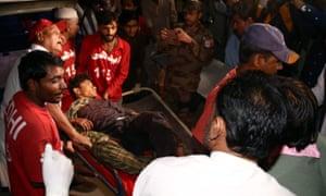 Medics carry a man on a stretcher