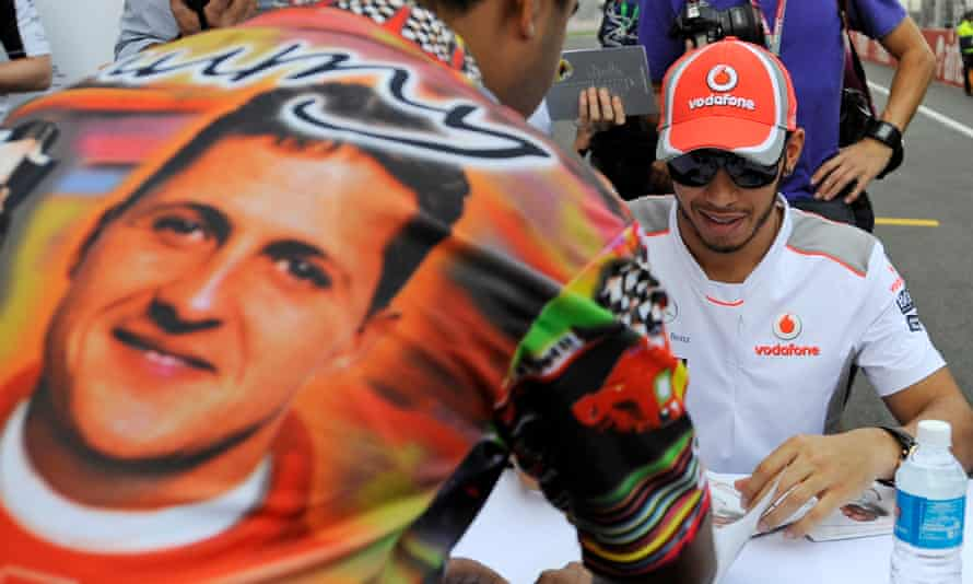 Lewis Hamilton signs during an autograph session with fans at the Buddh circuit on the outskirts of New Delhi in October 2012.