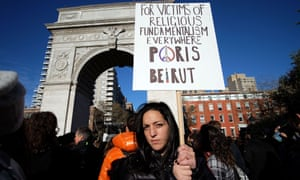 A woman displays a placard during a vigil to show solidarity with the citizens of France on November 14, 2015 in New York.