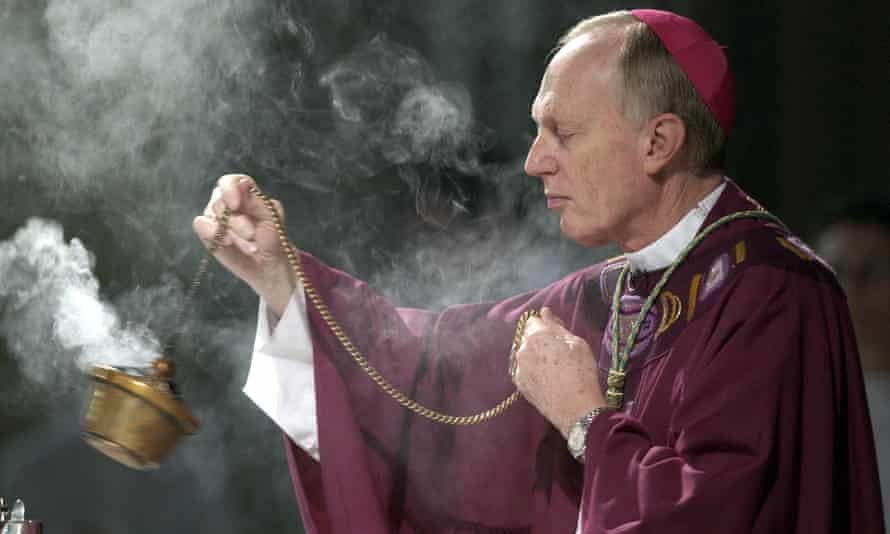 Bishop Howard Hubbard swings incense at the Cathedral of the Immaculate Conception in Albany, New York, in 2004.