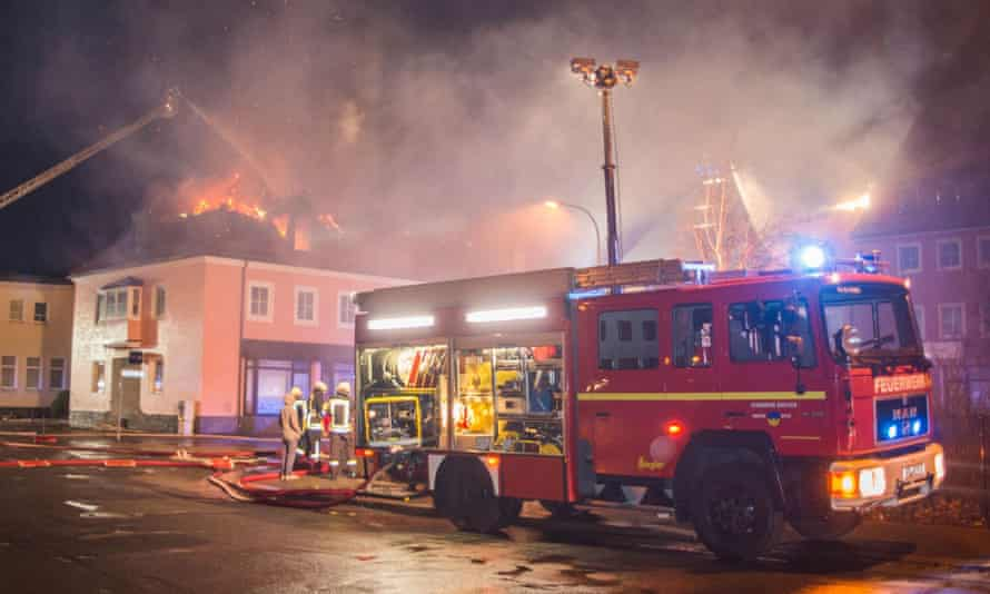 Firefighters tackle a fire in February at a former hotel in Bautzen, east of Dresden, which was being turned into a home for asylum seekers