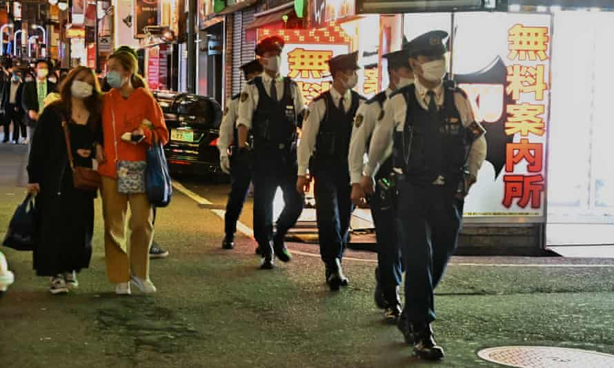 Members of Tokyo Metropolitan Police Department patrol at Kabukicho shopping and entertainment district in Tokyo, Japan on Friday, 30 April 2021. The organisers of the Tokyo Olympics have been forced to abandon plans to allow the sale of alcohol at venues after public outcry.
