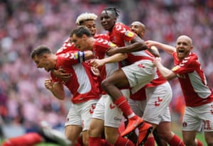 Charlton celebrate.