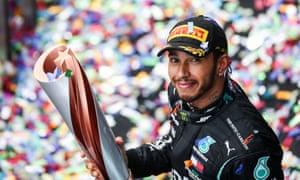 Lewis Hamilton shows off his seventh world title. When did he win his first?