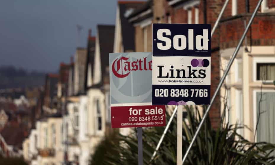 For sale and sold signs outside houses in north London