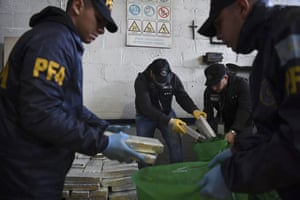 Police officers sort through illegal drugs in Buenos Aires on 10 May 2018.