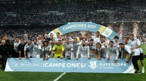 The Real Madrid players and staff celebrate with the trophy after winning the Spanish Super Cup.
