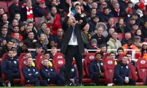 Burnley manager Sean Dyche urges on his team.