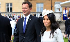 Jeremy Hunt and his wife, Lucia Guo, at Buckingham Palace