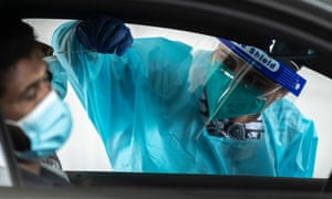 A health worker carries out a Covid test at the Merrylands drive-through in Sydney, Australia.