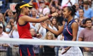 Emma Raducanu and Leylah Annie Fernandez embrace after Raducanu's win.