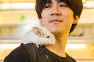 Wu Jia Rui, 25, with a short-tailed chinchilla (Chinchilla chinchilla) in the Guanyuan pet market in Beijing