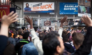Munich citizens and refugees cheer as the hard journey finds an end