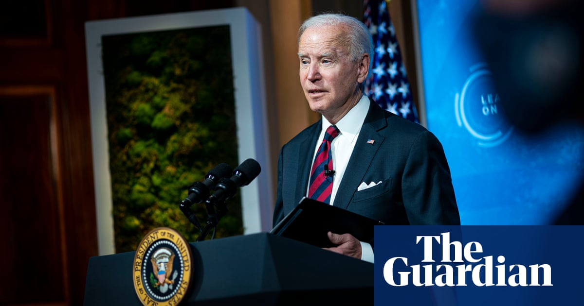 Biden vows to slash US emissions by half to meet 'existential crisis of our time' - The Guardian