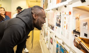 'Bruv, this is good!': Stormzy checks his page proofs as he visits the Observer Magazine offices.