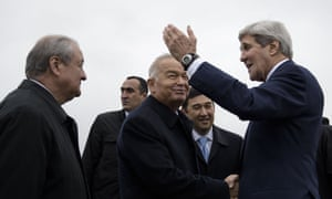 Uzbek Foreign Minister Abdulaziz Kamilov (L) looks on while Uzbek President Islam Karimov (C) and US Secretary of State John Kerry (R) shake hands at Samarkand Airport on November 1, 2015 in Samarkand. Kerry is in the region as he visits 5 Central Asian nations. AFP PHOTO/POOL/BRENDAN SMIALOWSKIBRENDAN SMIALOWSKI/AFP/Getty Images