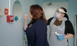 A visitor to King Charles Court care home in Falmouth, Cornwall, takes a rapid Covid test