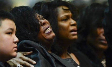 Kimberly Gunn cries at the funeral service for her brother Gregory Gunn at True Divine Baptist Church in Montgomery, Ala., Saturday, March 5, 2016. Gregory Gunn was fatally shot by Montgomery Police Officer Aaron Smith on Feb. 25. Smith has been arrested. (Julie Bennett/AL.com via AP) MANDATORY CREDIT