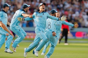 England's Jos Buttler celebrates after he ran out New Zealand's Martin Guptill of New Zealand to win the World Cup.
