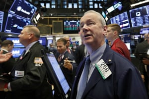 Trader James Riley works on the floor of the New York Stock Exchange