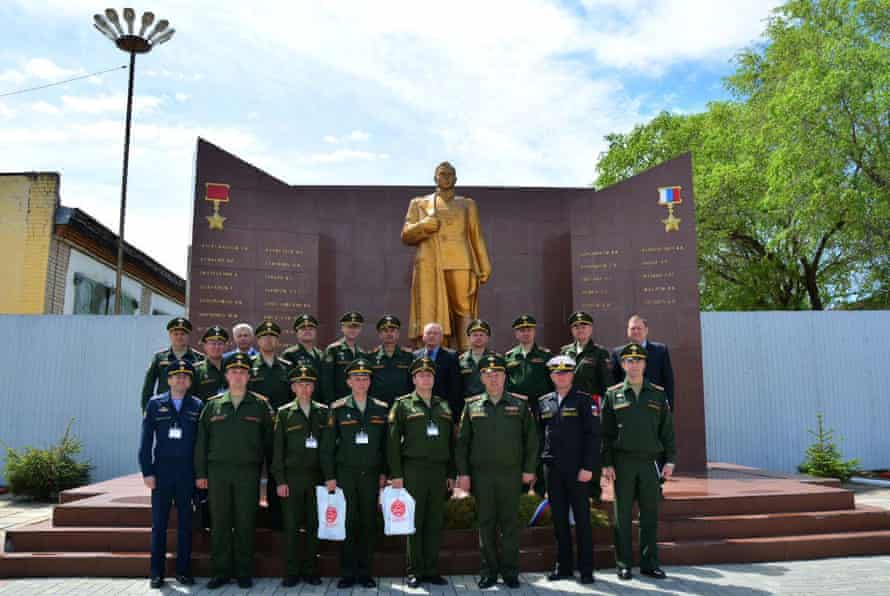 Russian military representatives pose in front of the memorial wall with Anatoliy Chepiga as the last name under the Gold Star honor list at the Far-Eastern Military Command Academy in Blagoveshensk, Russia. Picture taken May 24, 2017.