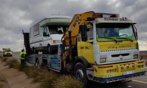 Andy and Sheila's motorhome on the back of a recovery lorry by a roadside in rural Morocco