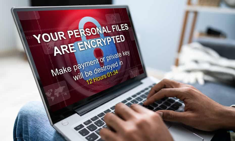 person with laptop displaying extortion demand