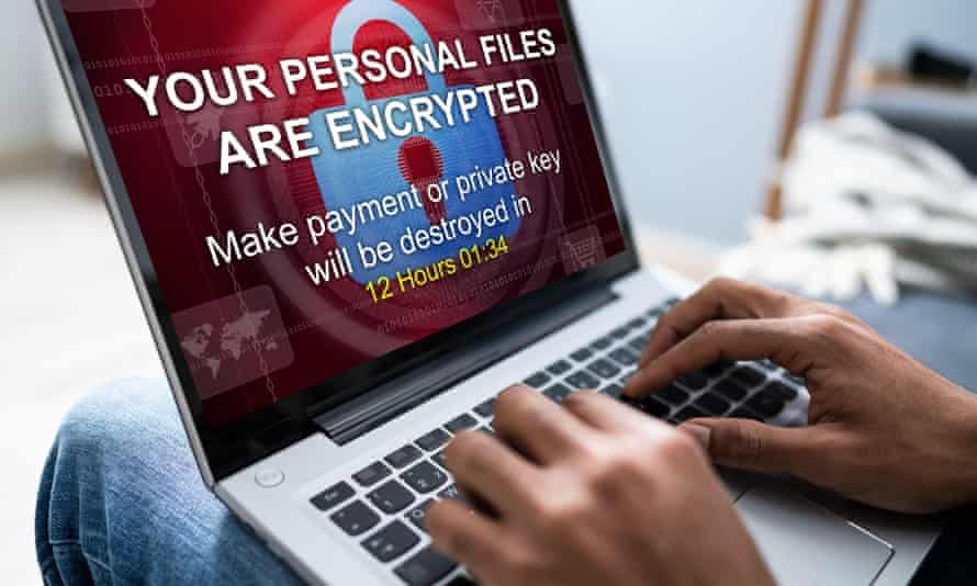 Close-up Of A Businessperson Looking At Laptop Screen Showing Personal Files Encrypted