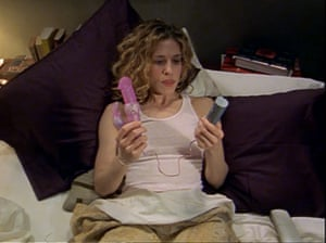 Carrie Bradshaw pondering her vibrator in Sex and the City.